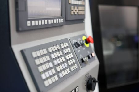 Modern lathe machine with CNC control panel in the foreground. Selective focus. Reklamní fotografie