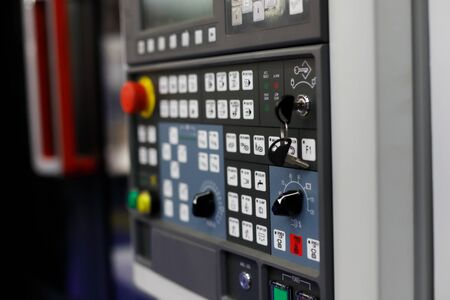 CNC milling machine with a control panel in the foreground. Selective focus. Reklamní fotografie