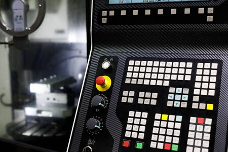 Control panel of multi-axis CNC machine. Selective focus.