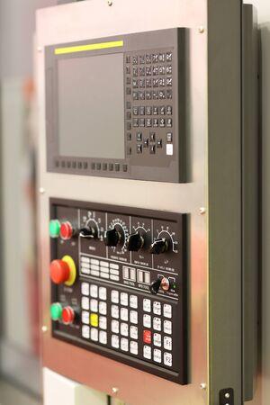 Modern CNC machine control panel close up. Selective focus.