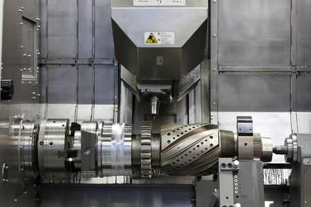 Workpiece at CNC turning, milling  and drilling machine. Selective focus.