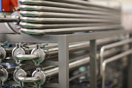 Stainless steel manufacturing equipment for the dairy industry. Selective focus.