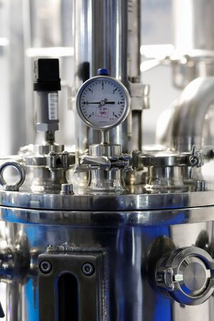 Stainless steel industrial equipment with pressure gauge. Selective focus. Stock Photo