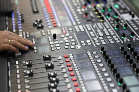 Closeup view of the broadcast audio mixing console. Selective focus.