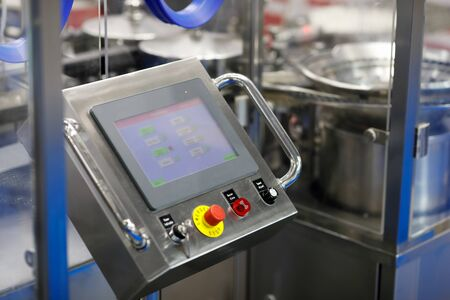 Pharmaceutical manufacturing and packaging equipment. Selective focus. Reklamní fotografie