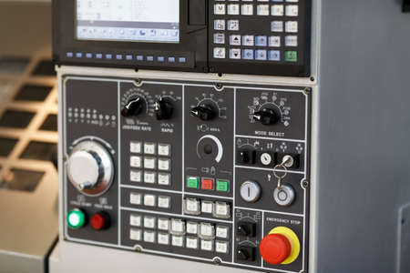 Control console of a CNC machining center. Selective focus. Stock fotó