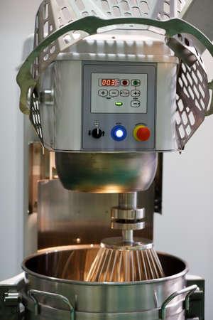 Industrial wheat flour kneader machine. Professional planetary bread dough mixer.