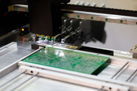 Automatic pick and place machine for PCB assembly. Surface mount technology. Selective focus.