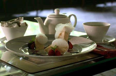 Tea drinking with  Italian dessert photo