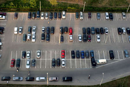 automobile dealership: Cityscape with cars on parking. The top view