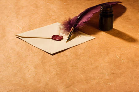 Still-life with a letter, a quill and an inkwell photo