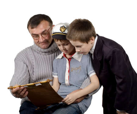 tells: The man shows a map and tells to boys about the far countries and travel