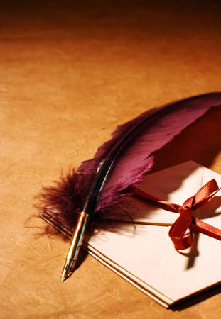 caligraphy: Still-life with a quill and a letters on a background of a rough paper surface Stock Photo