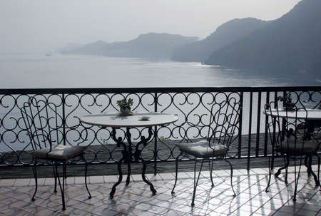View to the sea and mountains from a balcony of restaurant. Italy.  photo
