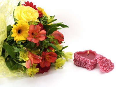 &#1040, flowers and a candle isolated on white background photo