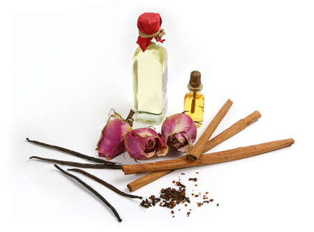 Spices, flowers and bottles with aromatherapy oil. Stock Photo - 2919731