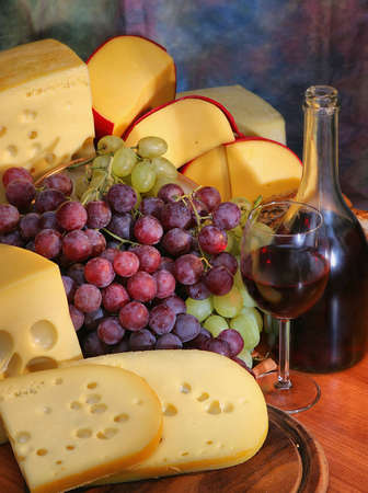 Still-life with grape, cheese and wine.