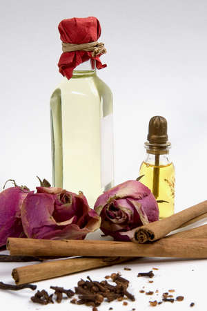 Spices, flowers and bottles with aromatherapy oil Stock Photo