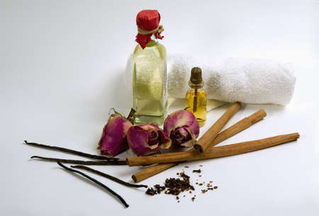 traquility: Spices, flowers and bottles with aromatherapy oil Stock Photo