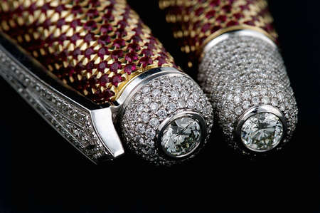 brilliants: Pen with diamonds and rubies isolated on black background Stock Photo