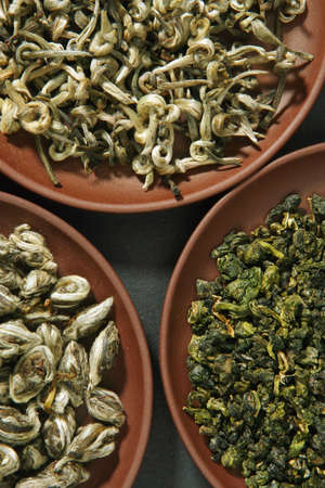 indigenous medicine: Chinese green teas on clay plates Stock Photo
