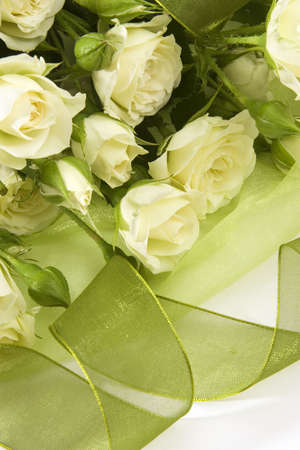 white roses with green tape