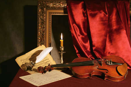 violin, candle & feather with ink  Stock Photo