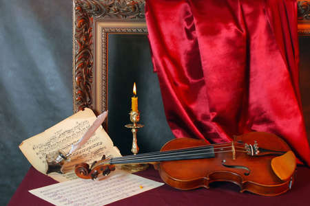 Retro still-life with a violin and music sheets . photo