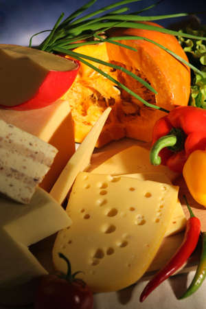 Still-life with cheese and vegetables from an autumn crop. Stock Photo - 3763795