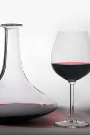 decanter: glass of wine and decanter.