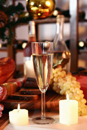 Glass of champagne, grapes  on a New Years background. photo
