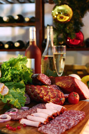 Wine and meat on a New Years background. photo