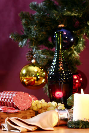 Wine, grapes and sausage on a New Years background. photo