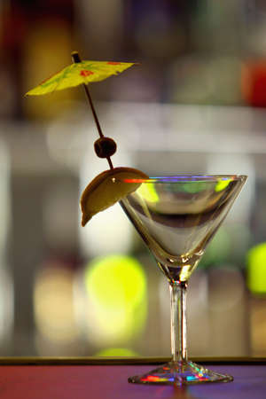 glasswear: Glass for martini on a table in a bar