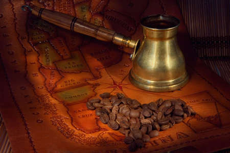 manufacturers: Coffee in a turk and grains on map of the South America