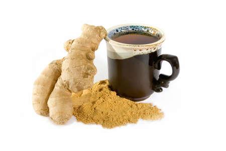 Tea with ginger powder in ceramic mug photo
