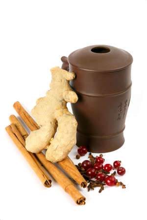 Curative tea with cinnamon, ginger, carnation and  berries photo