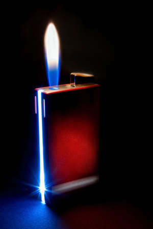 Red open lighter with flame isolated on black background. Stock Photo - 4467087