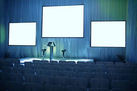 press conference: Empty big conference hall with podium and three screens