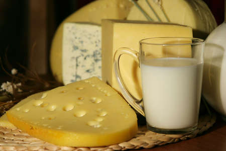 Still-life with dairy products - cheese and milk photo