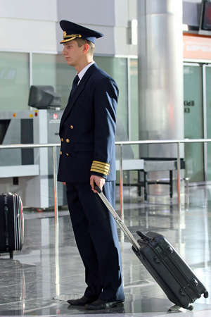 Air steward in a uniform at the airport