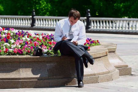 Successful young businessman working outdoor  photo