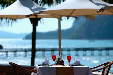 Restaurant places setting with romantic view to sea