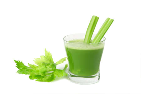 A glass of fresh celery juice  isolated on white background. Stock Photo