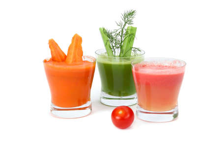 A glasses of fresh vegetable juice from tomatoes,carrot and  celery isolated on white background.