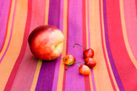 Still-life with fruit on a bright striped cloth  photo