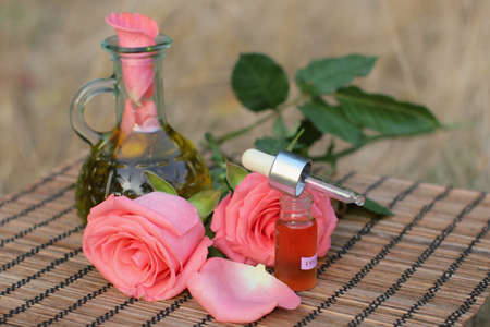 Aromatherapy concept.Bottles of essence oil with roses. Stock Photo - 5649801