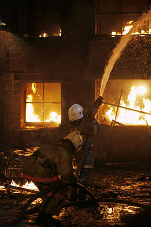 house fire: Firefighters fighting a fire