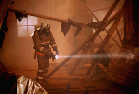 A rescuer search an accident victim in a smoke photo