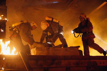 fire rescue: Rescue team help accident victim